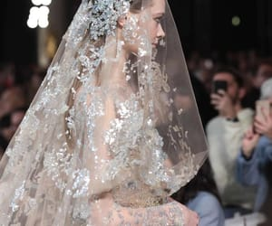 bridal gown, catwalk, and dress image