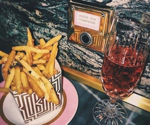 champagne, fries, and party image