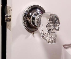 skull, door, and crystal image
