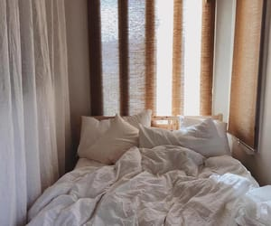 cozy bed, rustic bedroom, and natural sunlight image