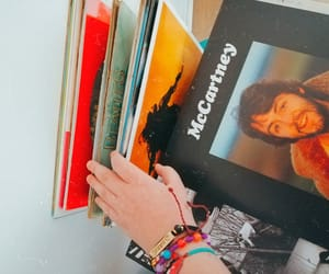 Paul McCartney, record player, and records image