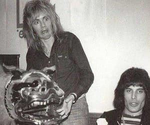 Queen, roger taylor, and Freddie Mercury image
