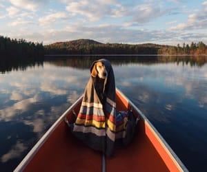 dog, lake, and boat image