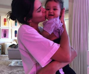 kendall jenner, stormi, and baby image