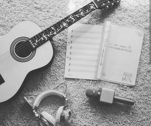 guitar, headphones, and singer image