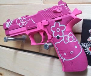 gun, hello kitty, and pink image