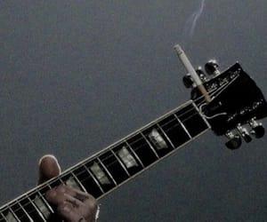 guitar, cigarette, and smoke image
