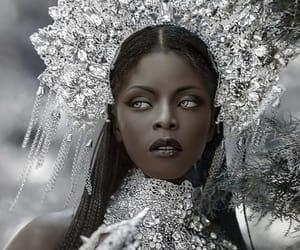 black, silver, and goddess image