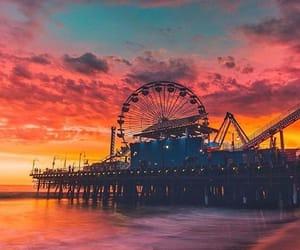 amusement park, pier, and sky image