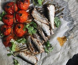 roast tomato, vinegar dressing, and sardine fish image