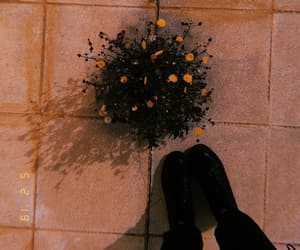 combat boots, flowers, and pavement image