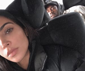 couple and kim kardashian image