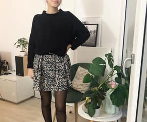 floral skirt, sweater, and suede boots image