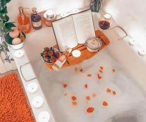 book, orange, and bath image