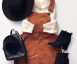 black boots, black bag, and brown image