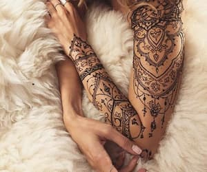 tattoo, arm, and henna image