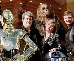 c3po, george lucas, and r2d2 image