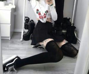 black skirt, white top, and rose design image