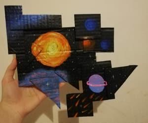 acrylic, jigsaw, and nebula image