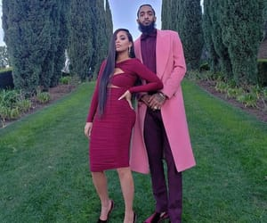 lauren london, nipsey, and hussle image
