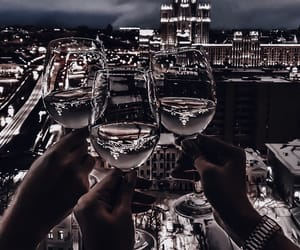 cheers, city lights, and drinks image