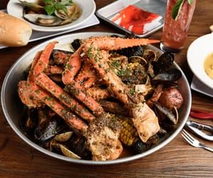 boil seafood house, the feast, and basil mussels image