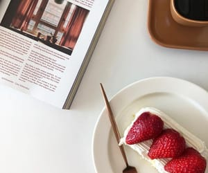 book, strawberry, and flatlay image