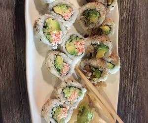 chopsticks, sushi, and tasty image