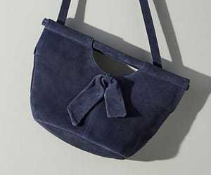 suede bow crossbody bag and anthropologie image
