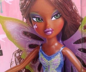 black girl, butterfly, and doll image