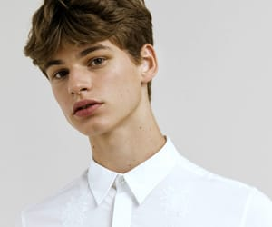 cute boy and top button done up image