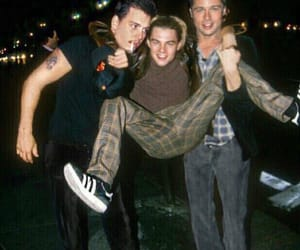 brad pitt, johnny depp, and leonardo dicaprio image