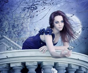 redhead blue dress, full moon blue dress, and balcony butterfly trees image