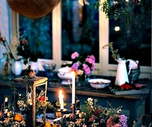 floral and candlelight, from the kitchen area, and cozy living quaters image