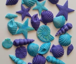 birthday cake, seashell, and cake decorations image