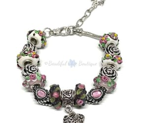 charm bracelet, glass beads, and pink image
