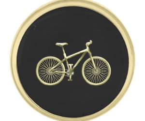 gold, label pin, and gold bicycle image
