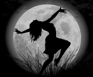 dancing shadow woman and full moon silhouette image