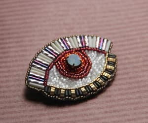 evil eye, geometric brooch, and modern embroidery image