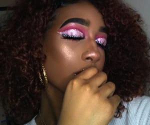 curly hair, pink makeup, and glowing image