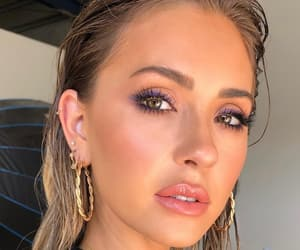 blush, earrings, and glossy lips image