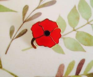 pin, poppies, and enamel pins image