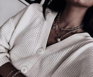bracelets, jewelry, and sweater image