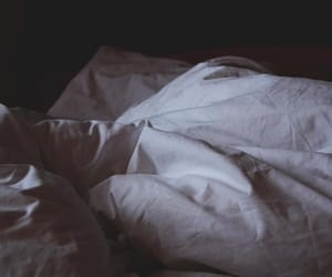 bed, sheets, and dark image