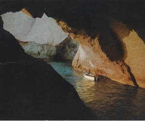 boat, cave, and water image