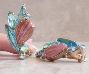 aurora borealis, rhinestone earrings, and gold tone metal image