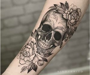 flower, skull, and arm image