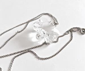 Swarovski, vintage jewelry, and snowflake charm image
