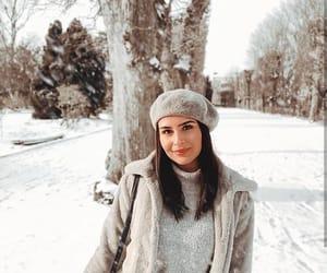 beret, coat, and cozy image