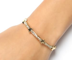 gold jewellery and bangle bracelet image
